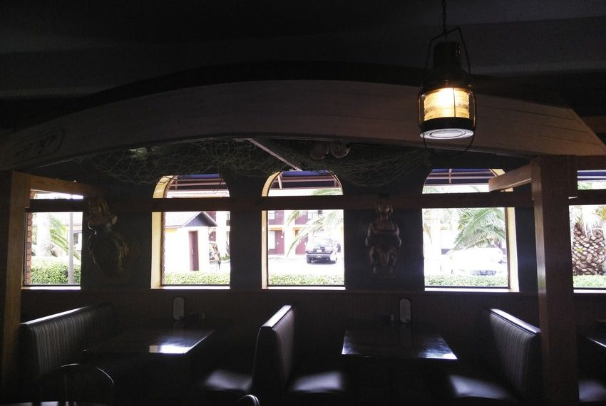 Zaharias St. Augustine Rear Dining Windows and Boat Decor